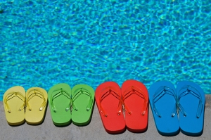 Colorful-Flip-Flops-Beside-A-Pool-Are-A-Great-Way-To-Get-Your-Kids-To-Where-Them-When-Walking-To-and-From-The-Pool